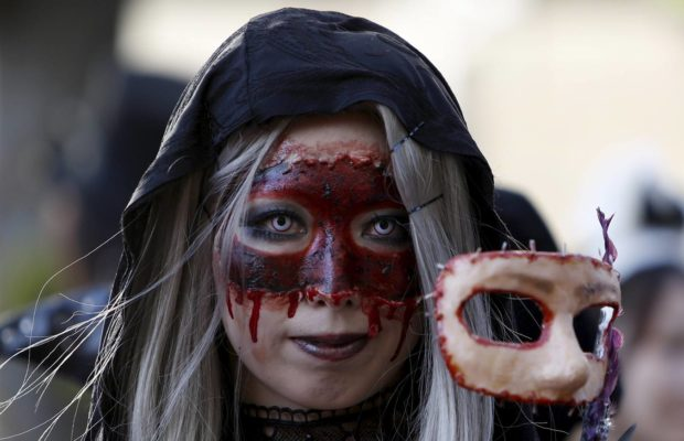 A participant in costume poses for a picture during a Halloween parade in Kawasaki, south of Tokyo, October 25, 2015. More than 100,000 spectators turned up to watch the parade, where 2,500 participants dressed up in costumes, according to the organiser. REUTERS/Yuya Shino